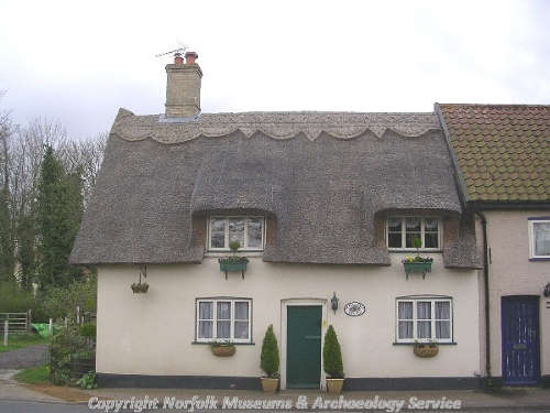 The Cottage on The Green, a clay lump and flint structure, dates from the early 18th century