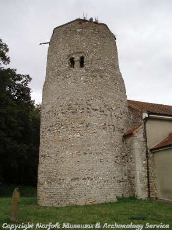 The Late Saxon round tower showing one of the unique belfry windows.