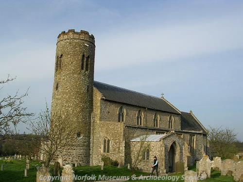 St Mary's Church in Roughton showing the Late Saxon round tower, the north aisle and the north porch.