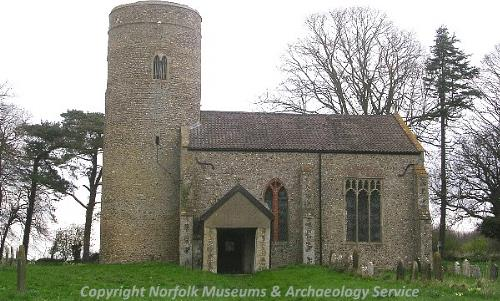 All Saints' Church, Runhall, showing the 12th century round tower, the nave and the site of the demolished chancel.