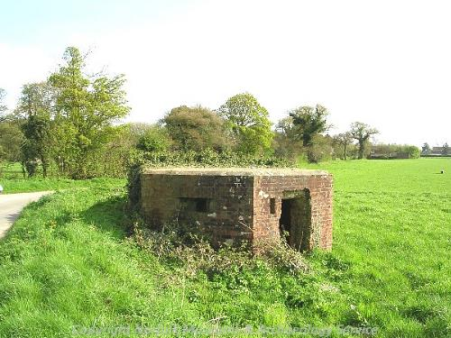 A World War Two pillbox near a crossroads.