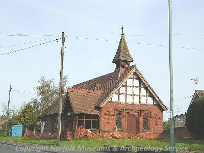 A 19th century red brick church.