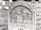 Late 19th century headstone depicting woman with flock of turkeys in St Mary's churchyard, Ashby St Mary.