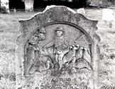 Late 19th century headstone depicting man with flock of turkeys in St Mary's churchyard, Ashby St Mary.