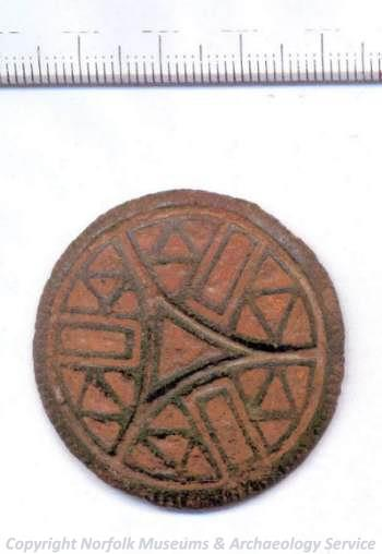 Front view of late 8th or early 9th century Irish or Viking enamelled stud.