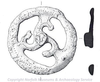 Illustration of Iron Age mount with a small human face in the centre.