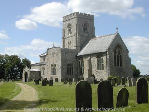 View of St Mary's Church showing the central tower, the chancel and the south porch.
