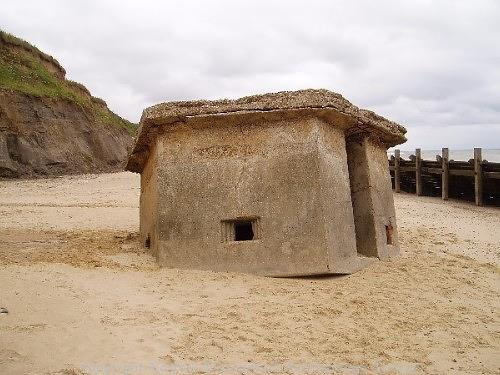 An upside-down World War Two pillbox that originally stood on the cliff top.