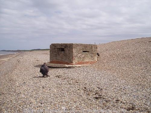 A World War Two pillbox on the beach at Kelling.