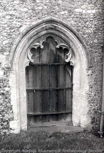 View of cusped south doorway, 14th century.